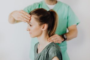 Neck Massage on Patient After Concussion | Tim Louis and Company